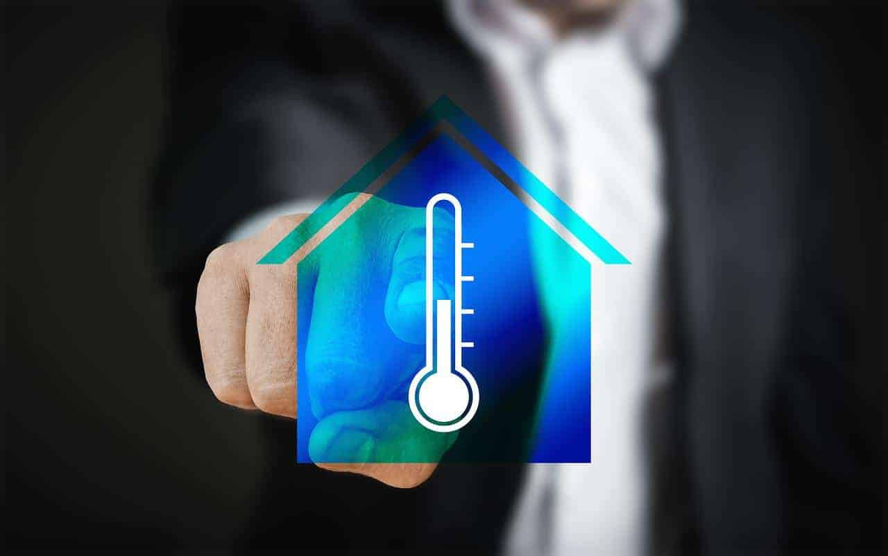 palec wskazujący na ikonę domu z termometrem